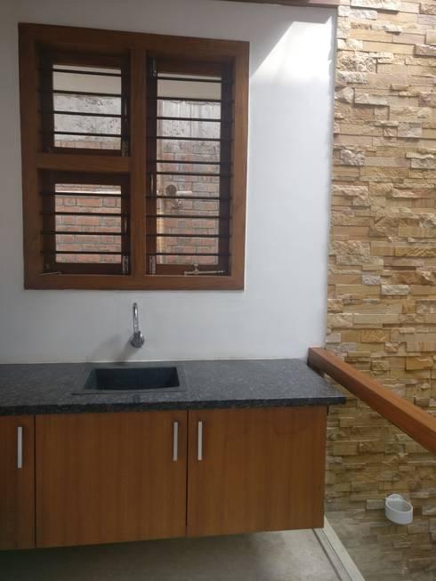 Utility Sink:  Corridor & hallway by Geometrixs Architects & Engineers