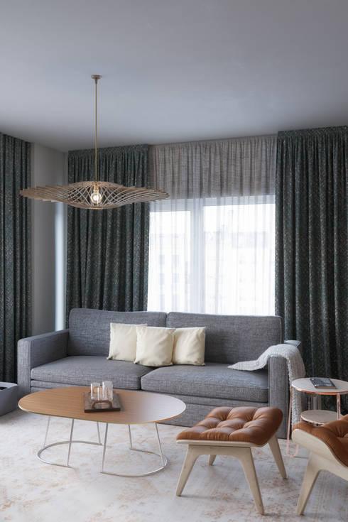 Elegant living area: Salones de estilo  de Isabel Gomez Interiors