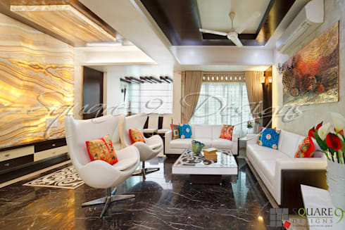 DRAWING HALL: modern Living room by Square 9 Designs