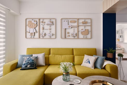 將卡通人物融合家的一份子:  客廳 by 層層室內裝修設計有限公司