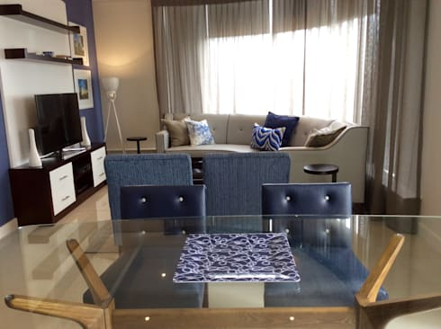 Bespoke TV Unit chairs and sofa using a glass table to take up less visual space. : modern Dining room by CS DESIGN
