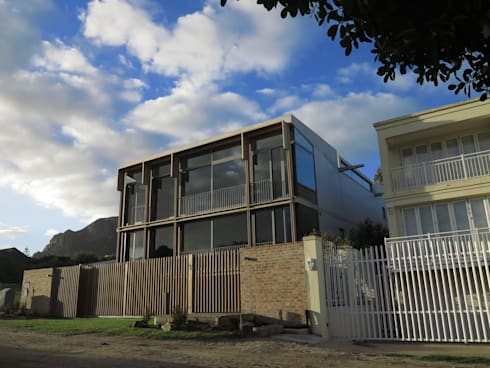 Street Elevation:  Single family home by Van der Merwe Miszewski Architects