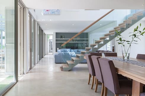 Dining Room, Lounge & Stair: modern Living room by Van der Merwe Miszewski Architects