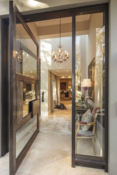 Elegant Entrance:  Glass doors by Spegash Interiors