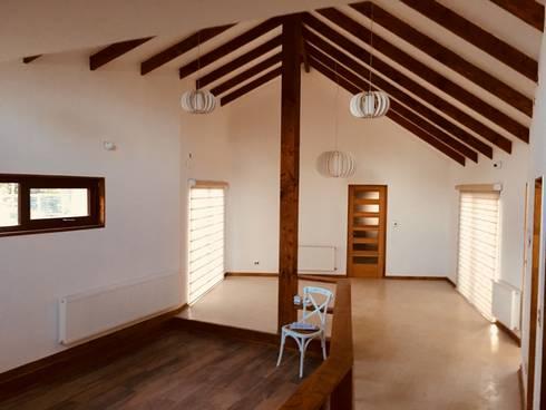 Vista Living Comedor: Livings de estilo clásico por Nomade Arquitectura y Construcción spa