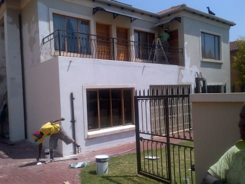Exterior Renovation: classic Houses by Kgodisho Solutions and Projects
