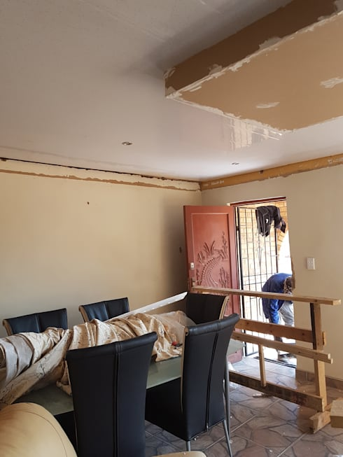 PVC Ceiling Instillation : classic Kitchen by Kgodisho Solutions and Projects