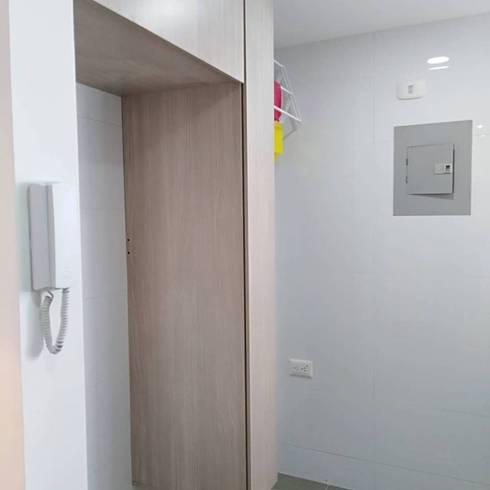 Apartaestudio: Puertas de estilo  por Erick Becerra Arquitecto