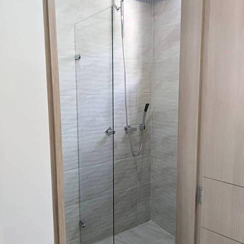 Apartaestudio: Baños de estilo moderno por Erick Becerra Arquitecto