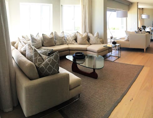 St Francis: modern Living room by ByDezign Interiors