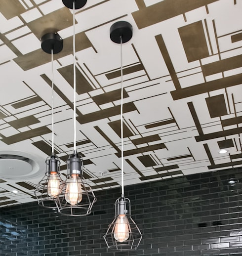 Ceiling laser cut detail: eclectic Dining room by white line interiors