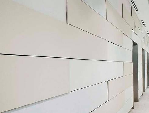 coating: Espacios comerciales de estilo  por Premium commercial remodeling