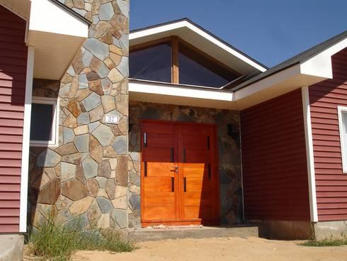 PORTAL ACCESO: Casas unifamiliares de estilo  por ARKITEKTURA