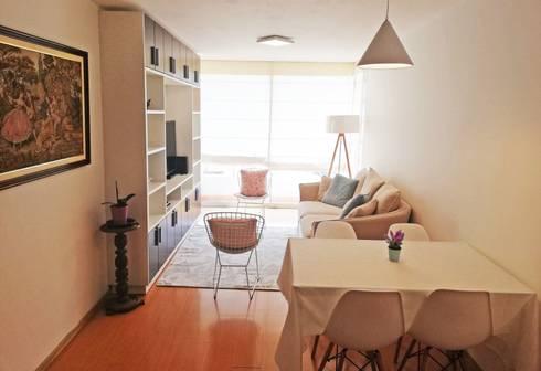 Departamento en colores pasteles: Salas / recibidores de estilo moderno por Mauriola Arquitectos