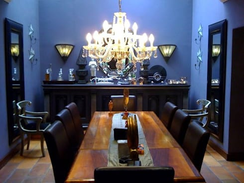 Bachelor's Art Deco Inspired Home: eclectic Dining room by CKW Lifestyle
