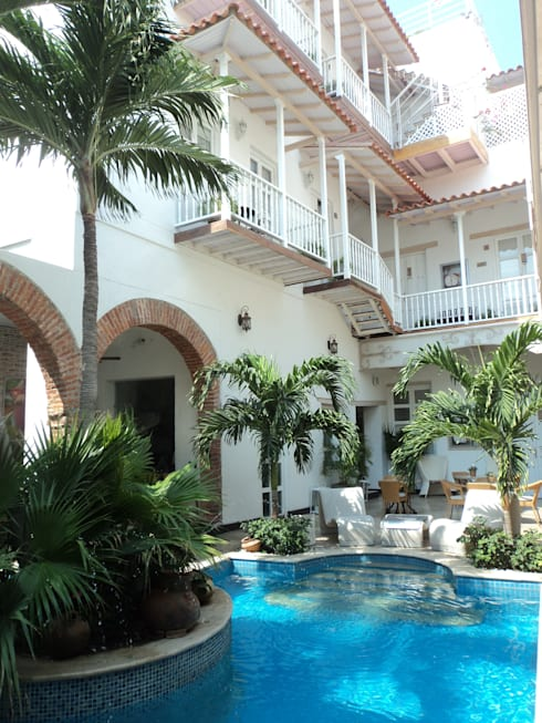 HOTEL BOUTIQUE DON PEPE:  de estilo  por ALTACONSTRUCCION S.A.S