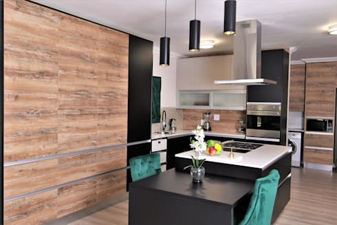 Kitchen:  Built-in kitchens by Motama Interiors and Exteriors
