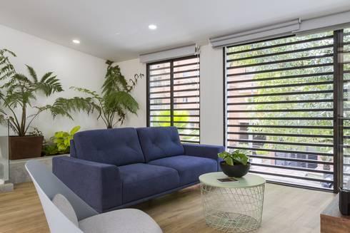 sala casa laureles: Salas de estilo moderno por Adrede Diseño
