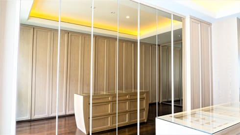 The Owner's Master Walk In Closet: modern Dressing room by ARF interior