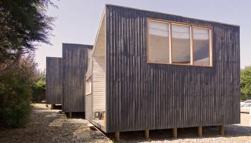 Cabañas Algarrobo: Cabañas de estilo  por m2 estudio arquitectos