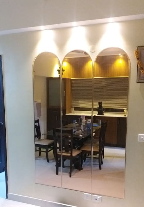 Mirror wall panelling: modern Dining room by Design Kreations