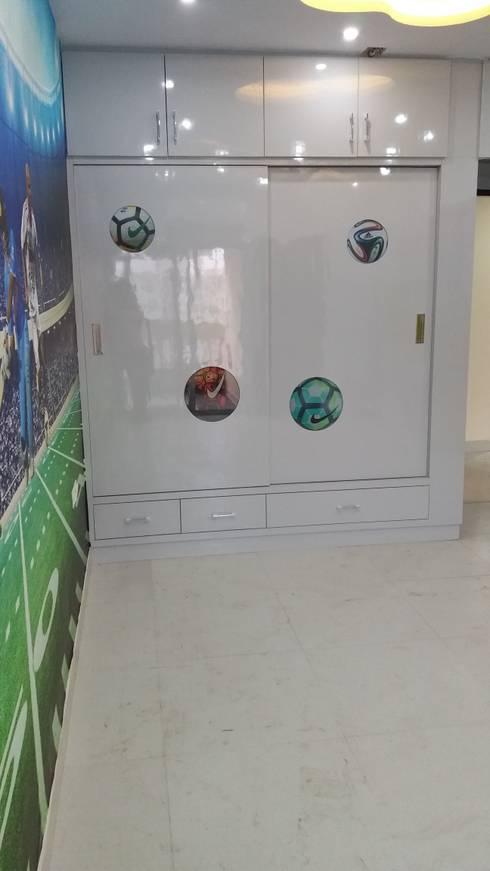 kids room Wardrobe (Sports Theme): modern Bedroom by Design Kreations