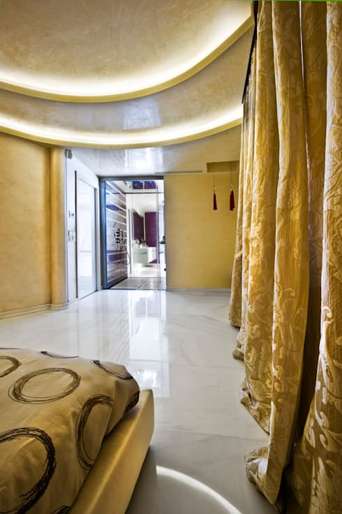 Luxury Interior Design: Camera da letto in stile  di Studio Merlini Architectural Concept
