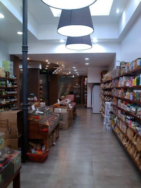Reciclado interior: Oficinas y locales comerciales de estilo  por Faerman Stands y Asoc S.R.L. - Arquitectos - Rosario