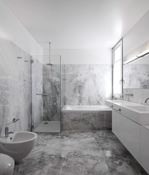 Projecto Xieira I: Casas de banho  por A2+ ARQUITECTOS