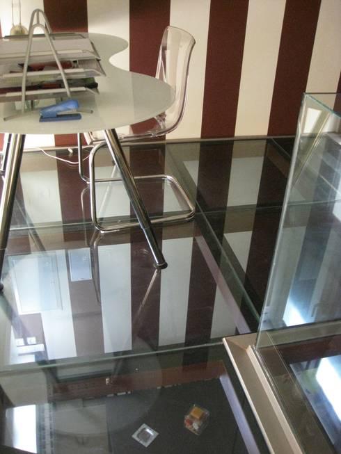 Forjado de cristal: Estudios y despachos de estilo  de Almudena Madrid Interiorismo