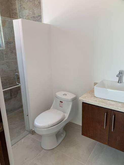 Banheiros  por D&C Hogar