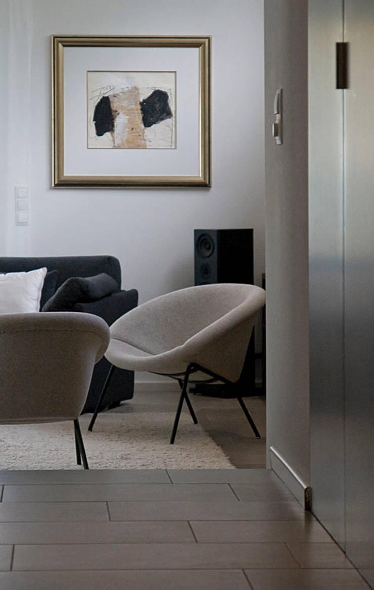 Famlienraum:  Wohnzimmer von  Design