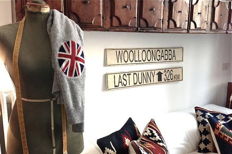 Appartment eines Modedesigners: koloniale Wohnzimmer von Phillys Interior Design