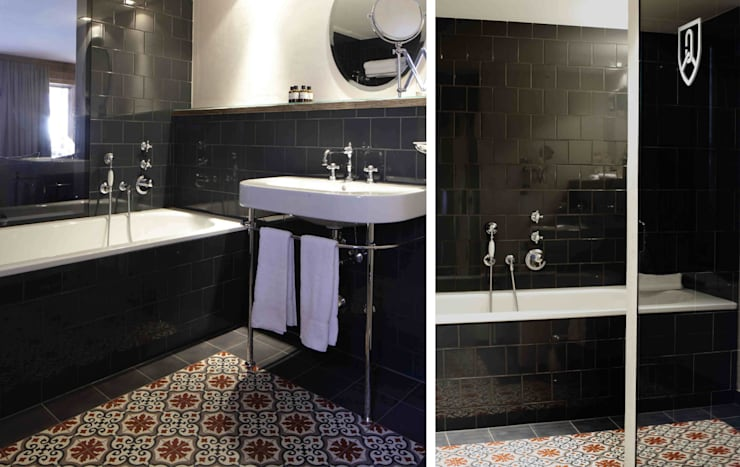hotel bathroom: industriale Badezimmer von c+c interiors berlin