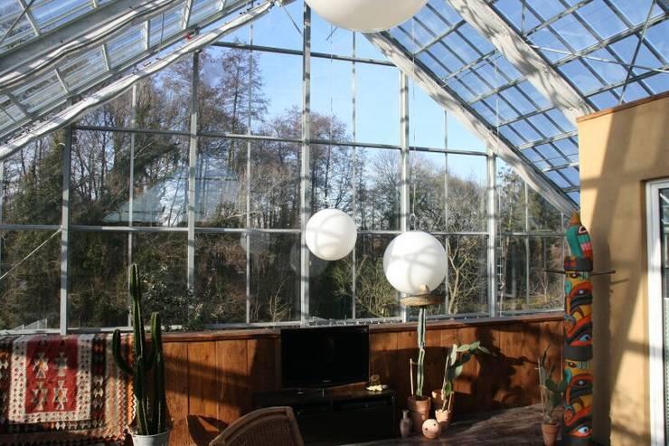 Salones de estilo ecléctico de Klaus Schmitz-Becker Architekt