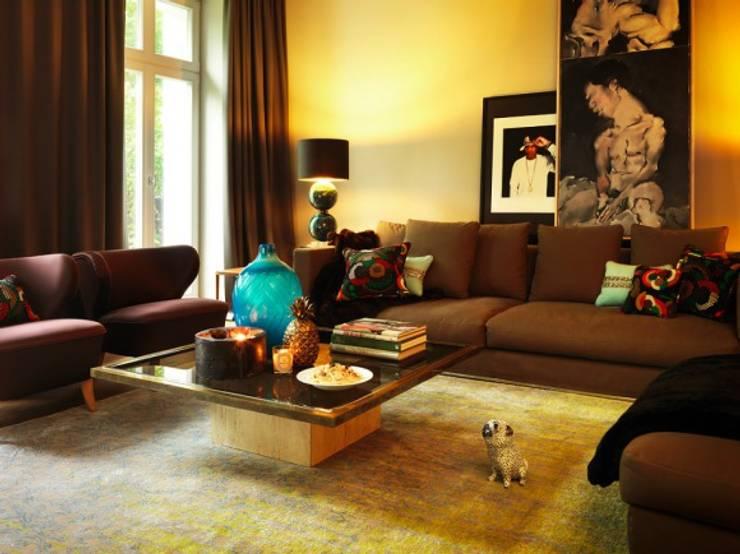 Kutscherhaus / Livingroom: ausgefallene Wohnzimmer von Conni Kotte Interior