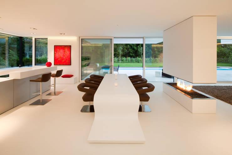 Sala da pranzo in stile in stile Moderno di HI-MACS®