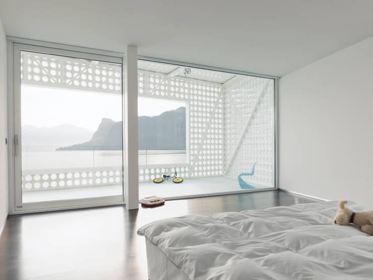 Slaapkamer door PHILIPPE STUEBI ARCHITEKTEN ETH BSA SIA GMBH