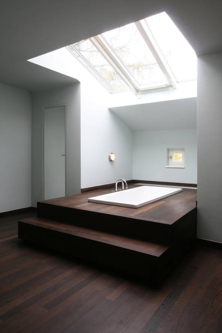 Baños de estilo  por CG VOGEL ARCHITEKTEN