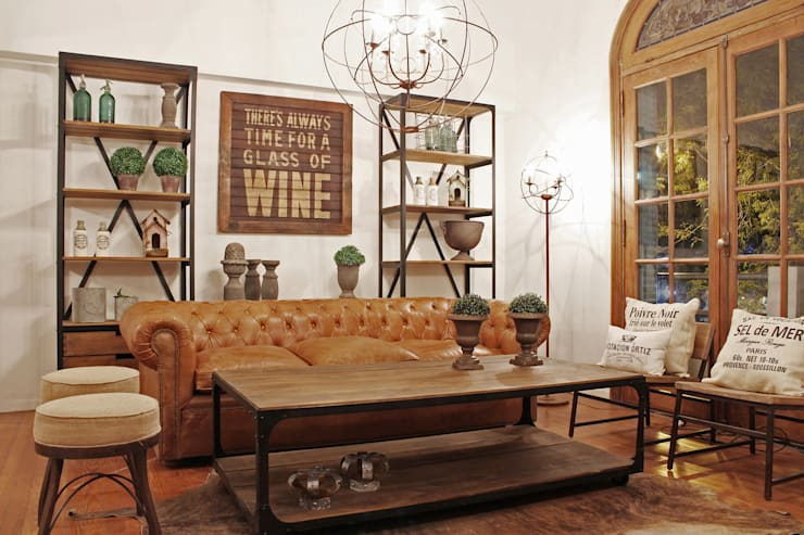 Living-room hierro y madera + chesterfield en cuero: Livings de estilo  por Estación Ortiz
