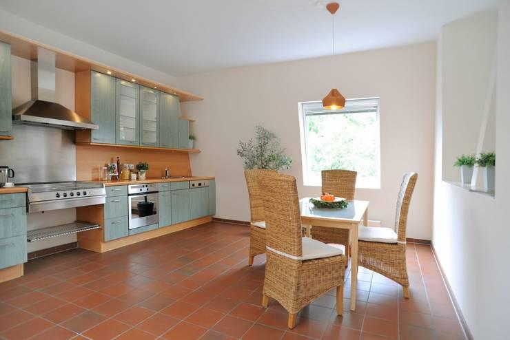 Cozinhas rústicas por WELLHAUSEN Immobilien Styling