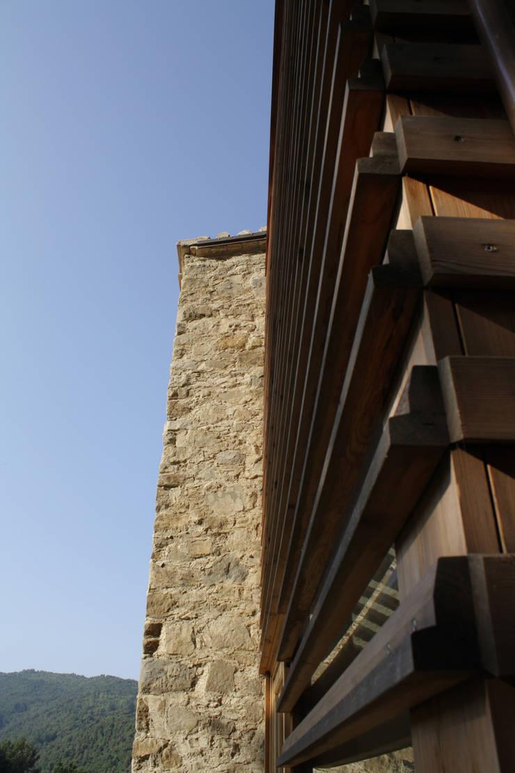 Casas de estilo  por Arcostudios