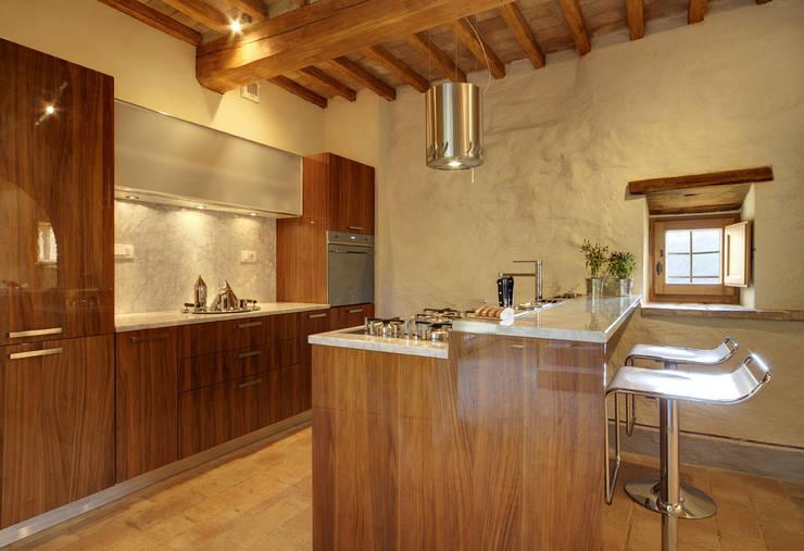 Cocinas de estilo  por Arcostudios