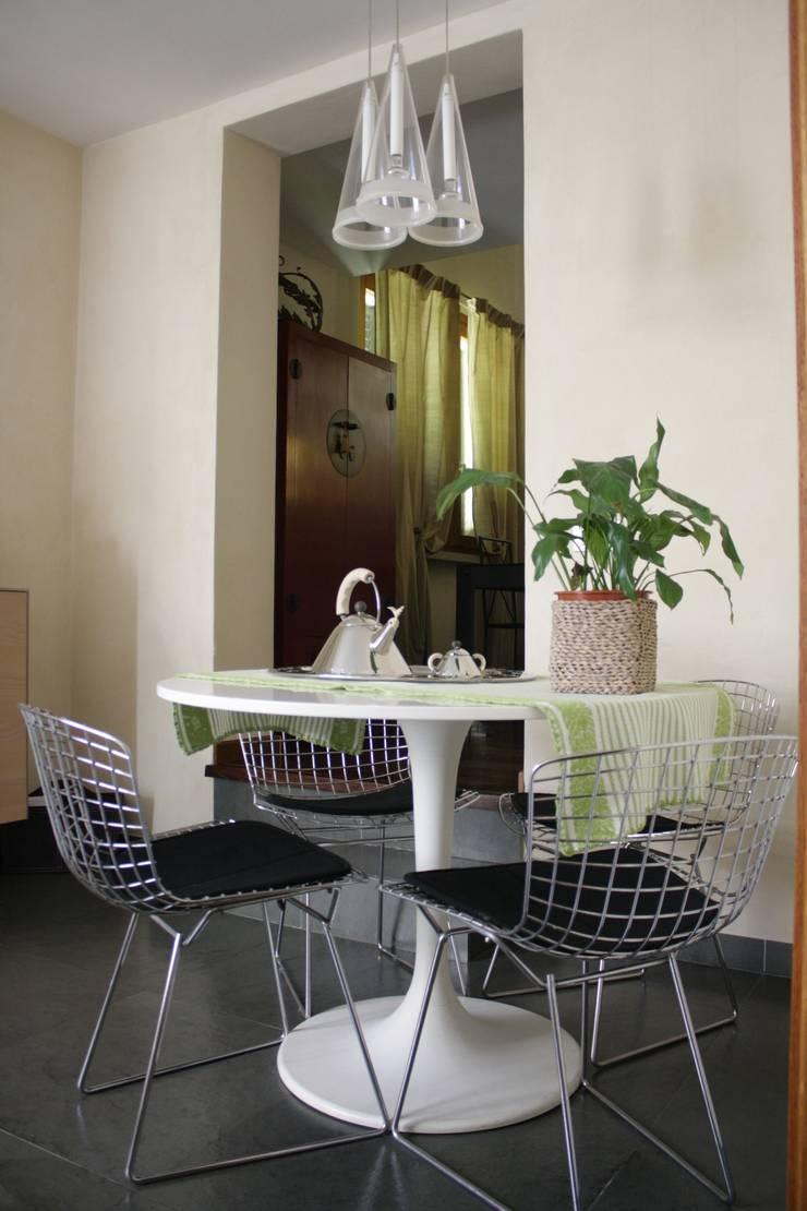 Salas de jantar  por Arcostudios