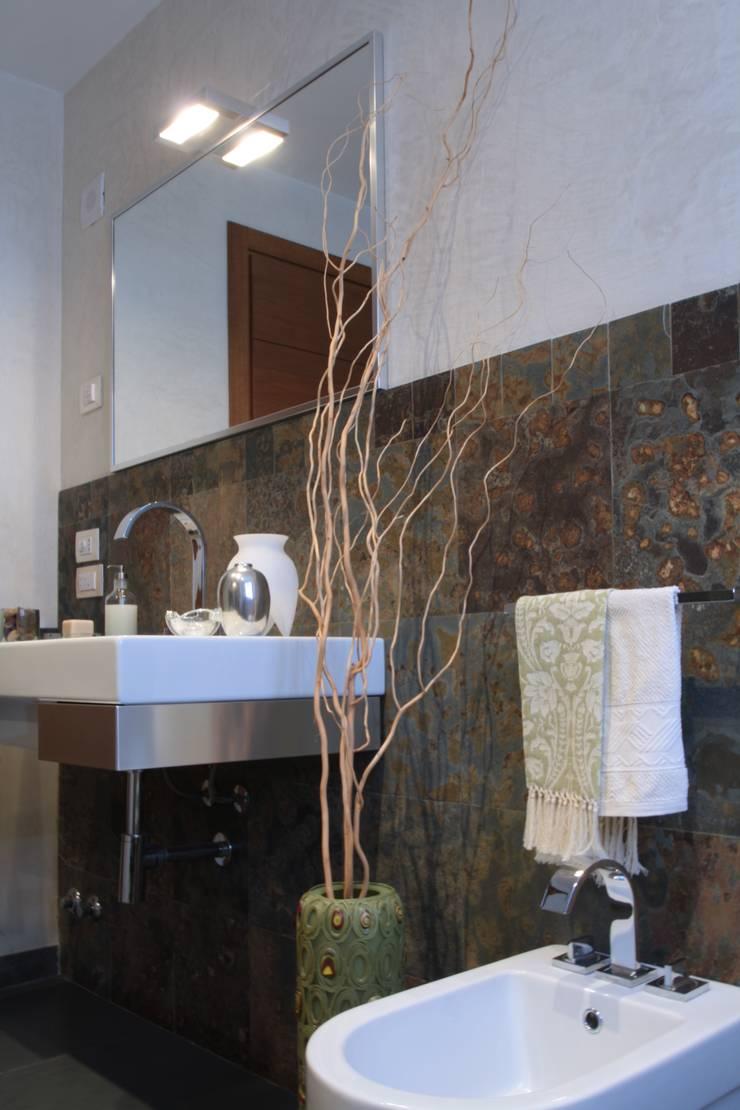 Banheiros  por Arcostudios