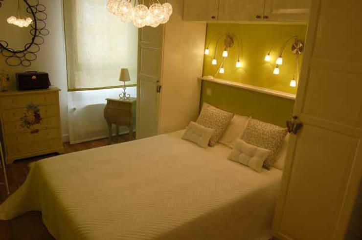 Pequeña Vivienda en Madrid: Dormitorios de estilo  de Arquitectura de Interior