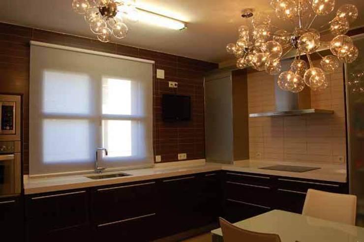 Vivienda en La Lastrilla Segovia: Cocinas de estilo  de Arquitectura de Interior