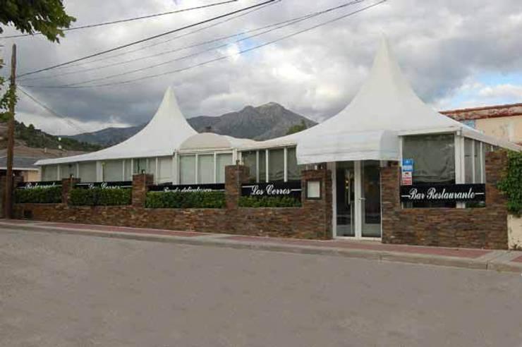 Restaurante Los Cerros : Comedores de estilo rural de Arquitectura de Interior