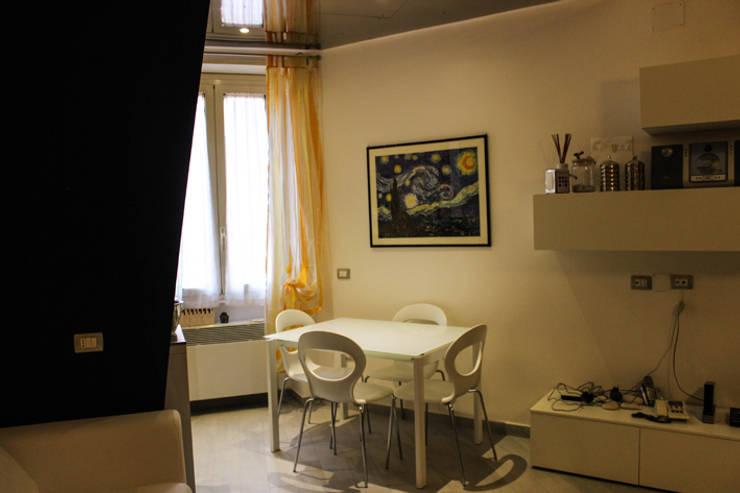 CASA MIGANI: Sala da pranzo in stile  di Alessio Patalocco Architetto