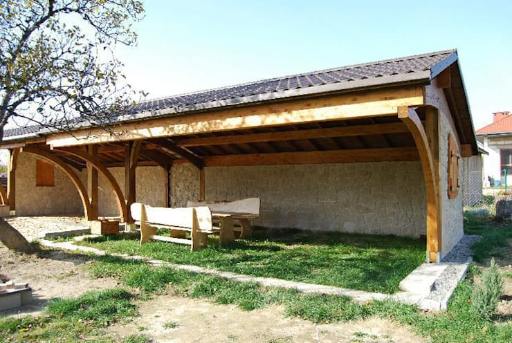 Glulam Curve Carport:  Garden by EcoCurves - Bespoke Glulam Timber Arches